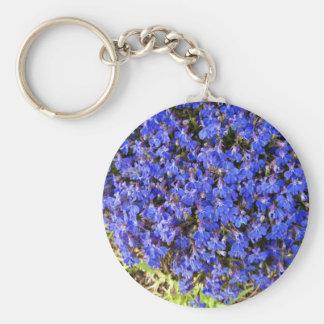 Grupo de flores azules vivaces llavero
