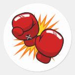 Guantes de boxeo del dibujo animado etiqueta redonda