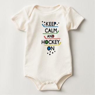 Guarde al bebé de la calma y del hockey encendido mamelucos