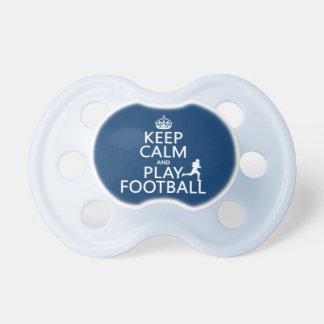 Guarde el fútbol de la calma y del juego (el color chupete de bebé