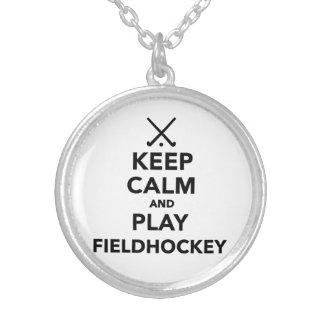 Guarde el hockey hierba de la calma y del juego colgante redondo