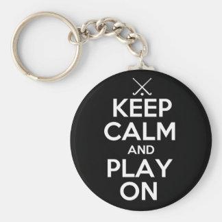 Guarde el hockey hierba de la calma y del juego en llavero redondo tipo pin