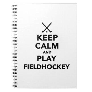 Guarde el hockey hierba de la calma y del juego libretas