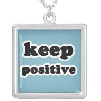 Guarde el positivo en azul colgante cuadrado