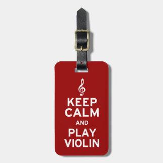 Guarde el violín de la calma y del juego etiquetas maletas