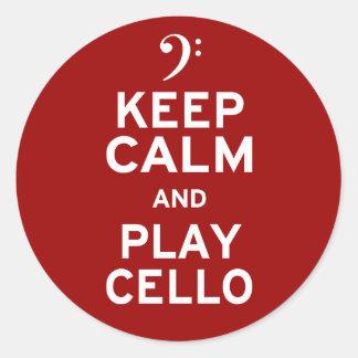 Guarde el violoncelo de la calma y del juego pegatina redonda