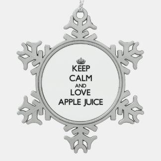 Guarde el zumo de manzana de la calma y de amor adorno de peltre en forma de copo de nieve
