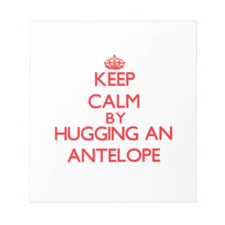 Guarde la calma abrazando un antílope blocs de papel
