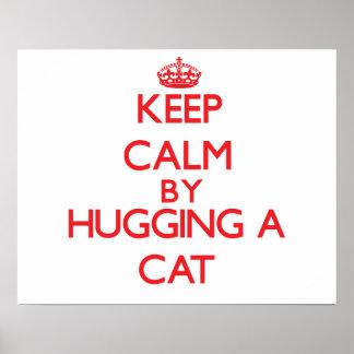 Guarde la calma abrazando un gato póster