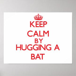 Guarde la calma abrazando un palo posters
