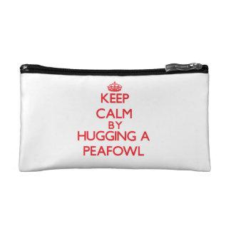 Guarde la calma abrazando un Peafowl