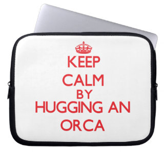 Guarde la calma abrazando una orca manga computadora