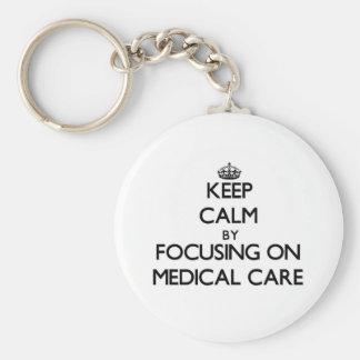 Guarde la calma centrándose en asistencia médica llaveros