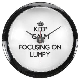 Guarde la calma centrándose en aterronado relojes aqua clock