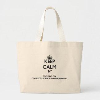 Guarde la calma centrándose en de informática y bolsas