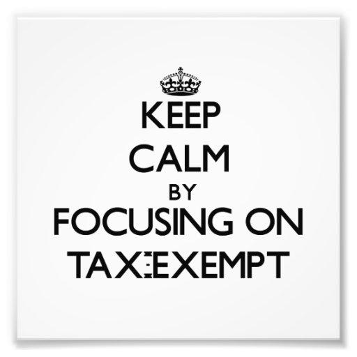 Guarde la calma centrándose en exento de impuestos fotos