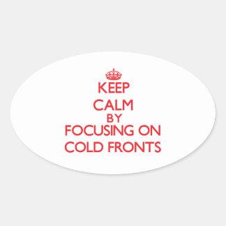 Guarde la calma centrándose en frentes fríos pegatina ovalada