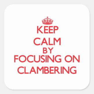 Guarde la calma centrándose en la escalada calcomanía cuadradas