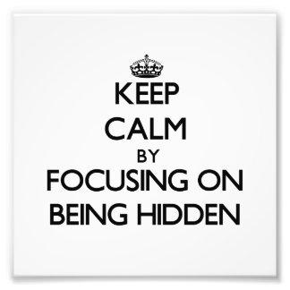 Guarde la calma centrándose en la ocultación fotografías