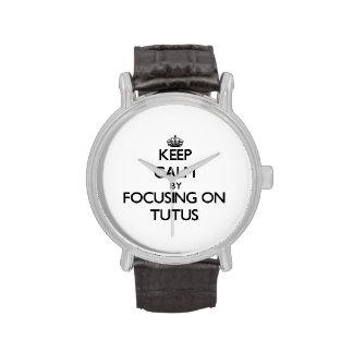 Guarde la calma centrándose en los tutúes relojes de mano