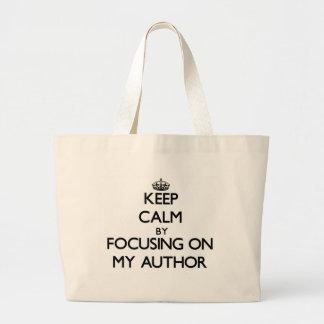Guarde la calma centrándose en mi autor bolsas de mano