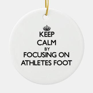 Guarde la calma centrándose en pie de atletas