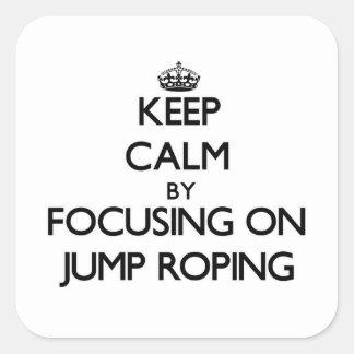 Guarde la calma centrándose en Roping del salto Colcomanias Cuadradas