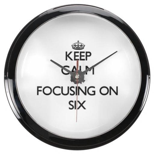 Guarde la calma centrándose en seis reloj aqua clock