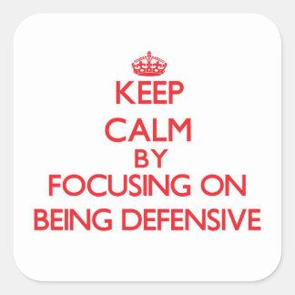 Guarde la calma centrándose en ser defensivo colcomanias cuadradas