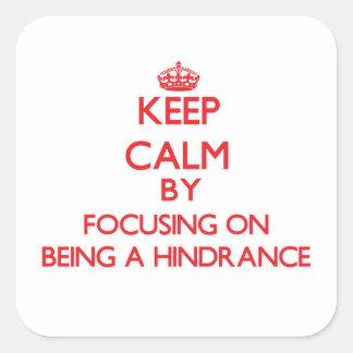 Guarde la calma centrándose en ser un obstáculo pegatina cuadrada