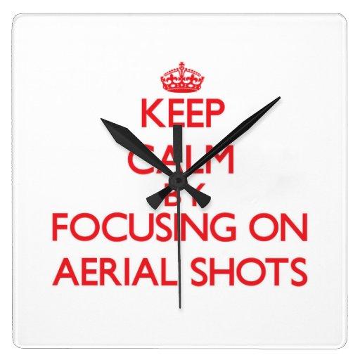 Guarde la calma centrándose en tiros aéreos reloj