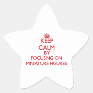 Guarde la calma centrándose encendido en figuras calcomanía forma de estrella