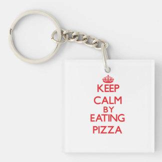 Guarde la calma comiendo la pizza llaveros