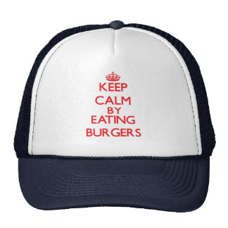 Guarde la calma comiendo las hamburguesas gorros