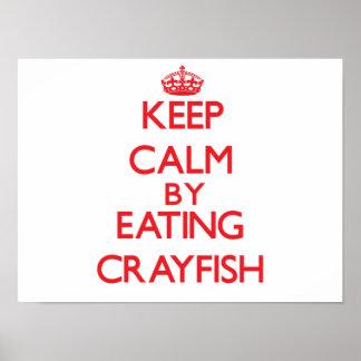 Guarde la calma comiendo los cangrejos posters