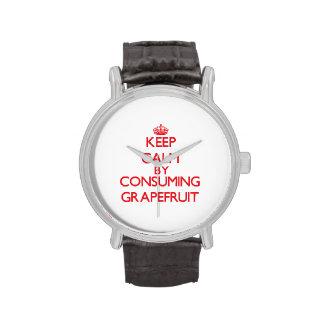 Guarde la calma consumiendo el pomelo reloj