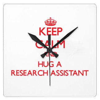 Guarde la calma y abrace a un asistente de investi relojes