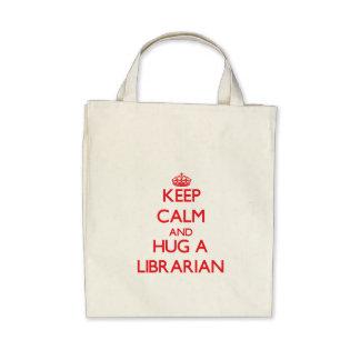 Guarde la calma y abrace a un bibliotecario bolsa de mano
