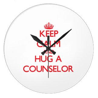 Guarde la calma y abrace a un consejero reloj