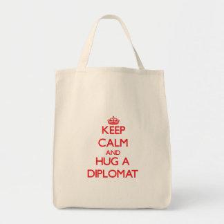 Guarde la calma y abrace a un diplomático bolsa tela para la compra