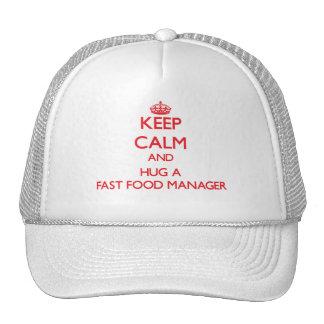 Guarde la calma y abrace a un encargado de los ali gorras