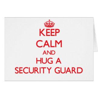 Guarde la calma y abrace a un guardia de seguridad tarjeta