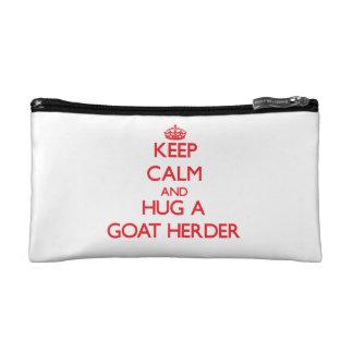 Guarde la calma y abrace a un pastor de la cabra