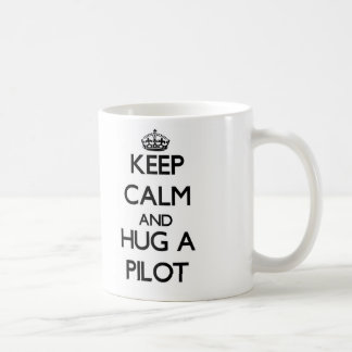 Guarde la calma y abrace a un piloto taza de café
