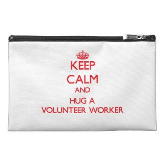 Guarde la calma y abrace a un trabajador voluntari