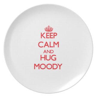 Guarde la calma y abrace cambiante plato de comida