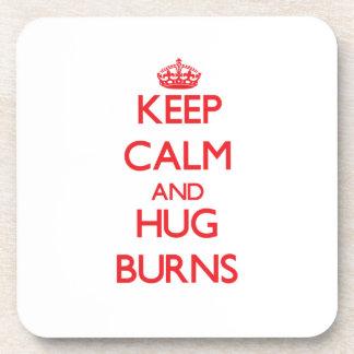 Guarde la calma y abrace las quemaduras posavasos