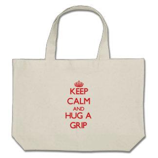 Guarde la calma y abrace un apretón bolsas de mano