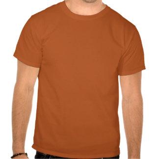 Guarde la calma y al palo de golf en las camisetas