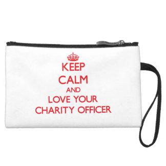 Guarde la calma y ame a su oficial de la caridad